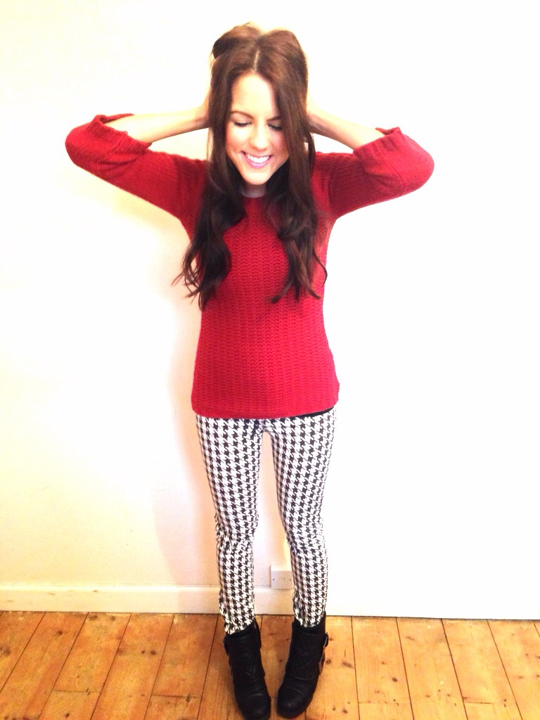 A picture of a girl wearing Zara dogtooth trousers, Zara red jumper and Kurt Geiger black ankle boots