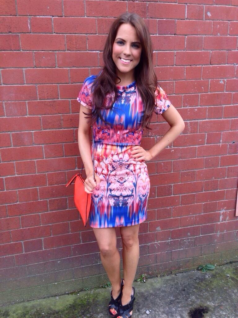 A picture of a girl wearing a Zara neoprene printed dress
