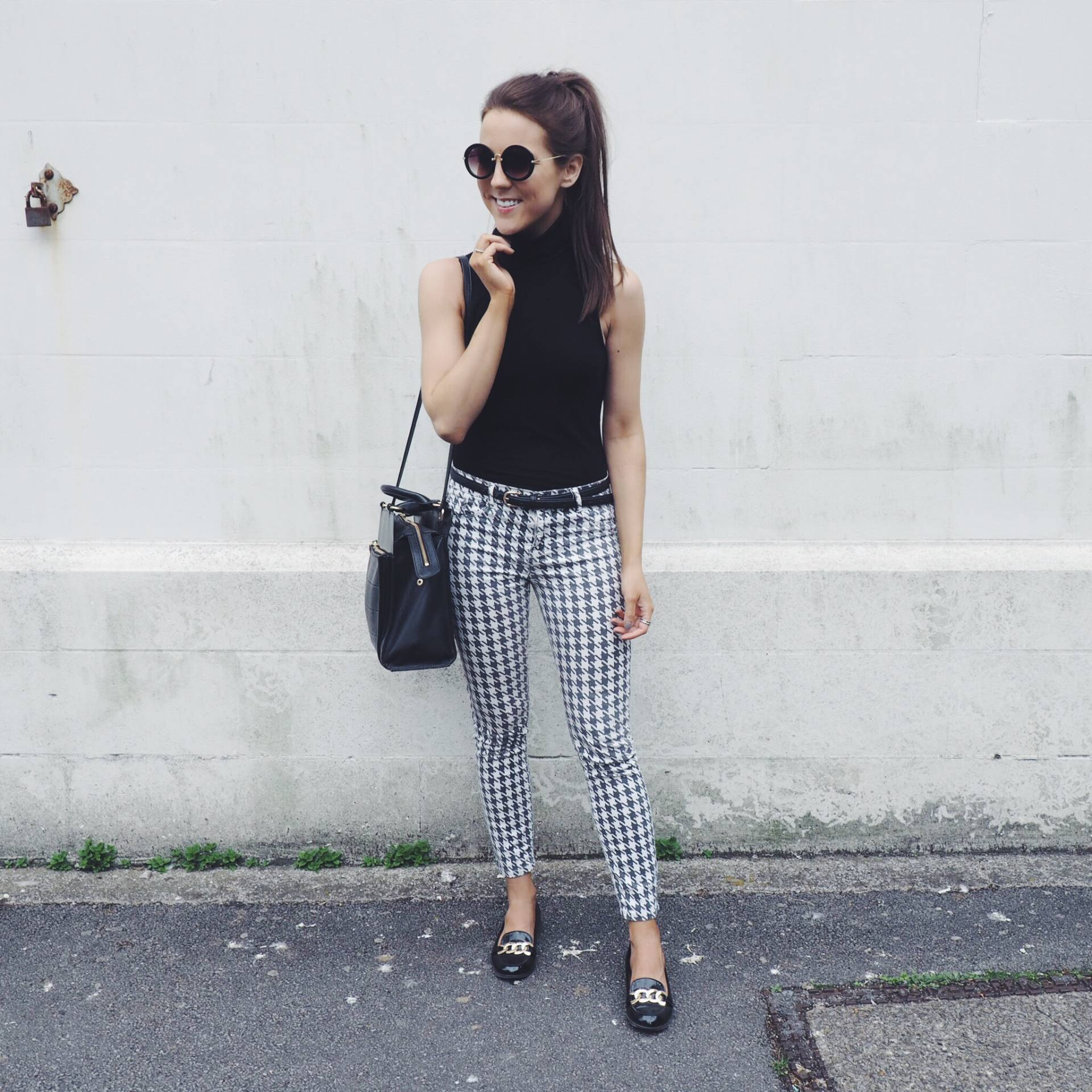 A picture of a fashion blogger wearing Zara dogtooth trousers, Radley handbag, H&M roll neck top and River Island loafers