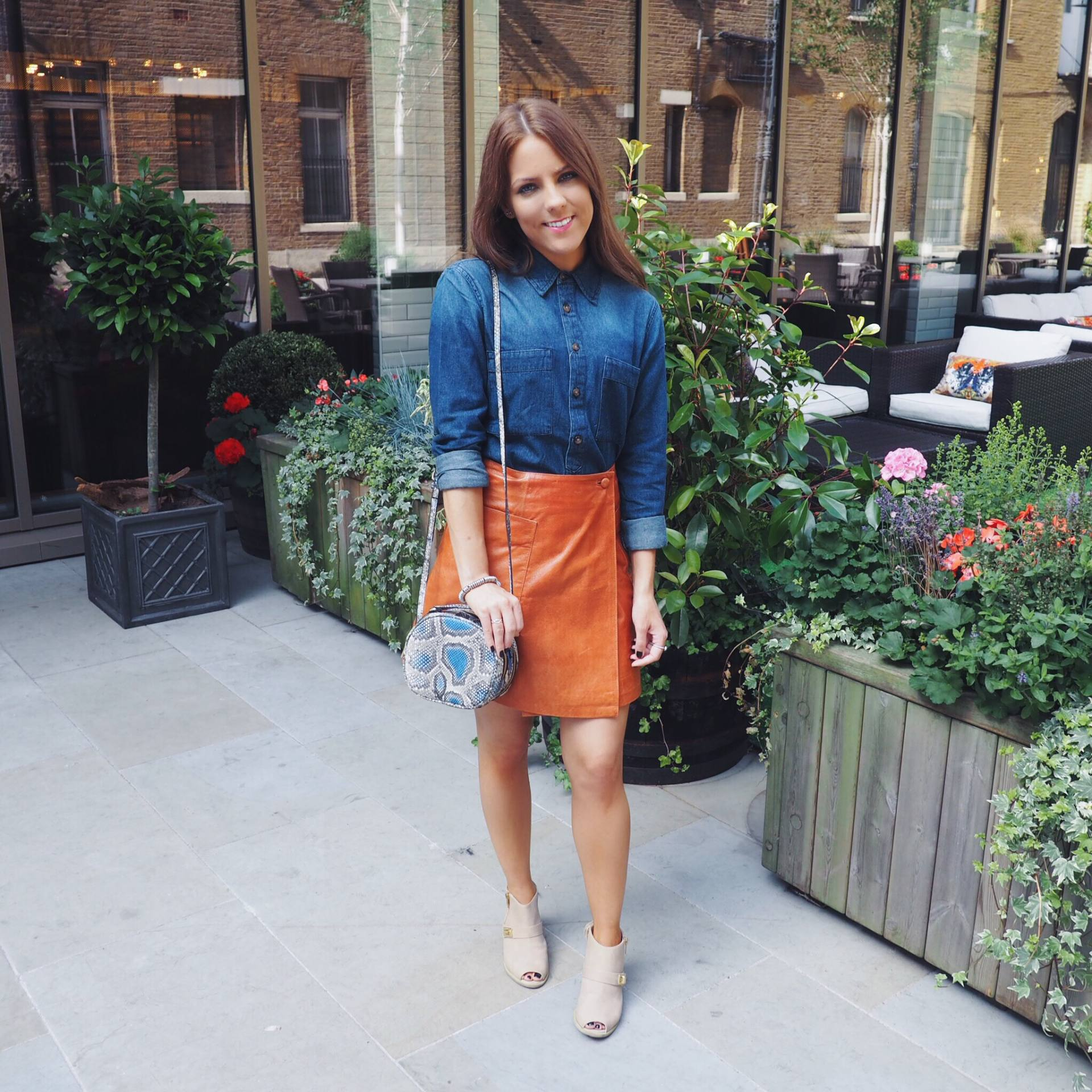 ASOS denim shirt and ASOS leather wrap skirt