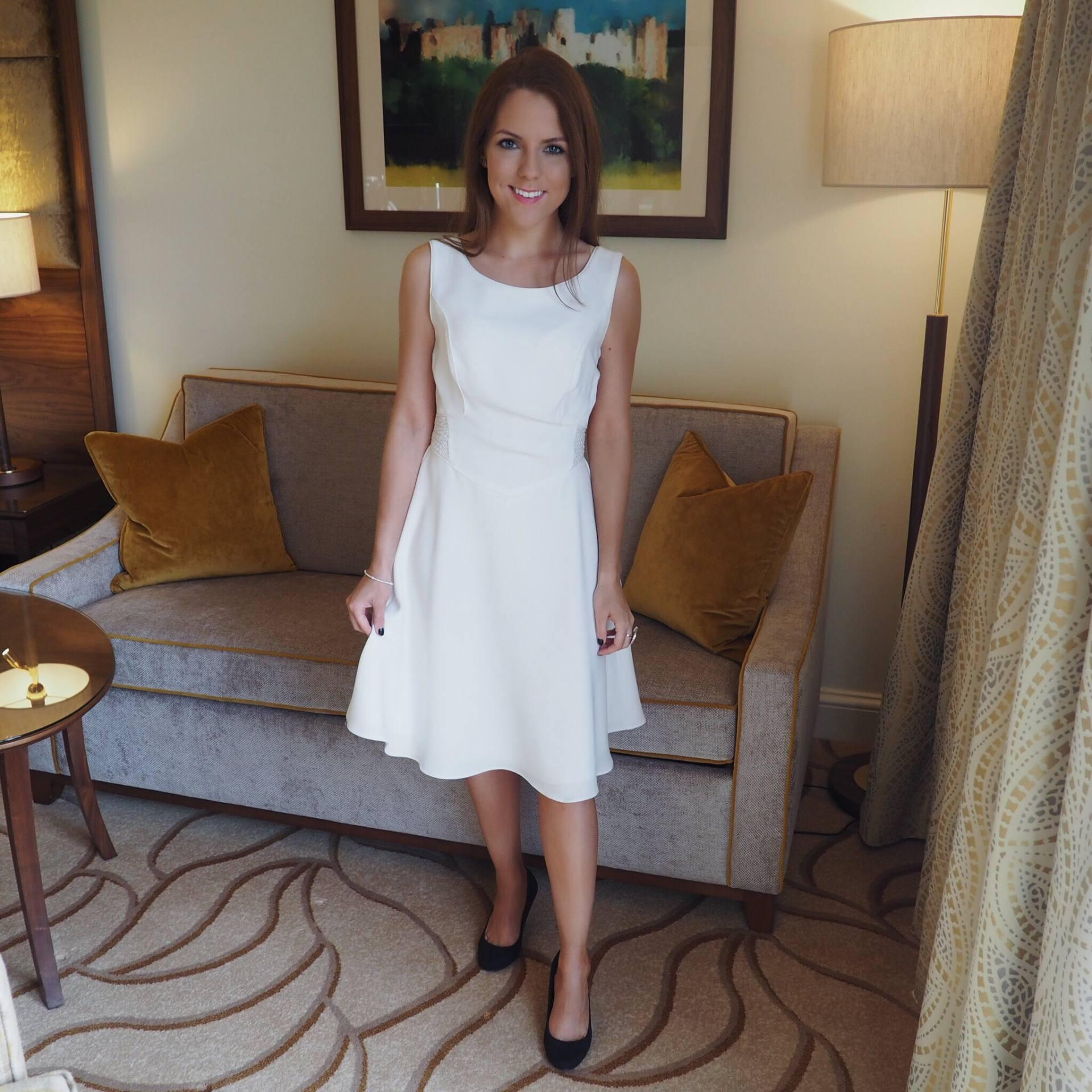 Blogger Georgia Hathaway wearing white REISS dress