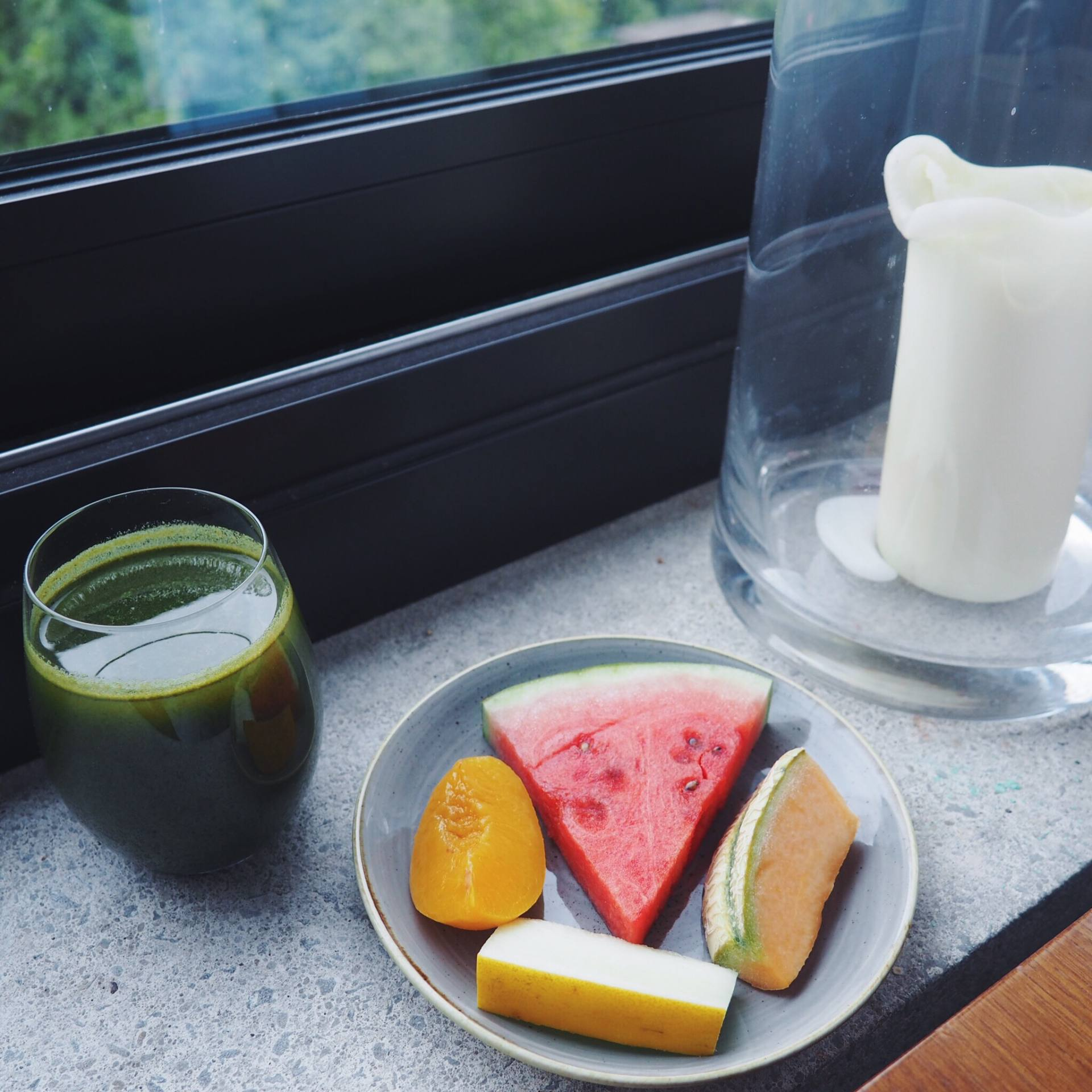 Fresh fruit and green juice for breakfast