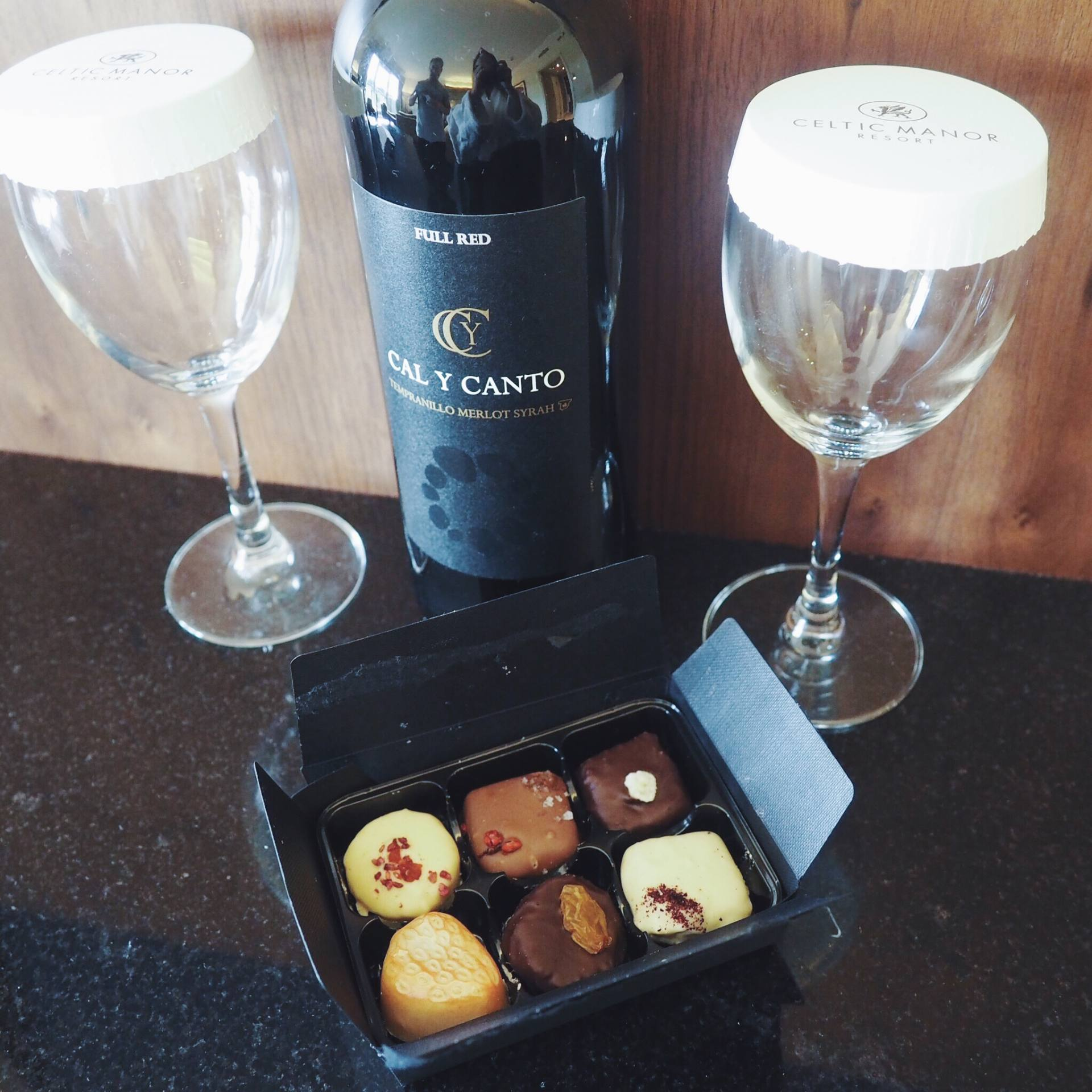 A picture of red wine and chocolates