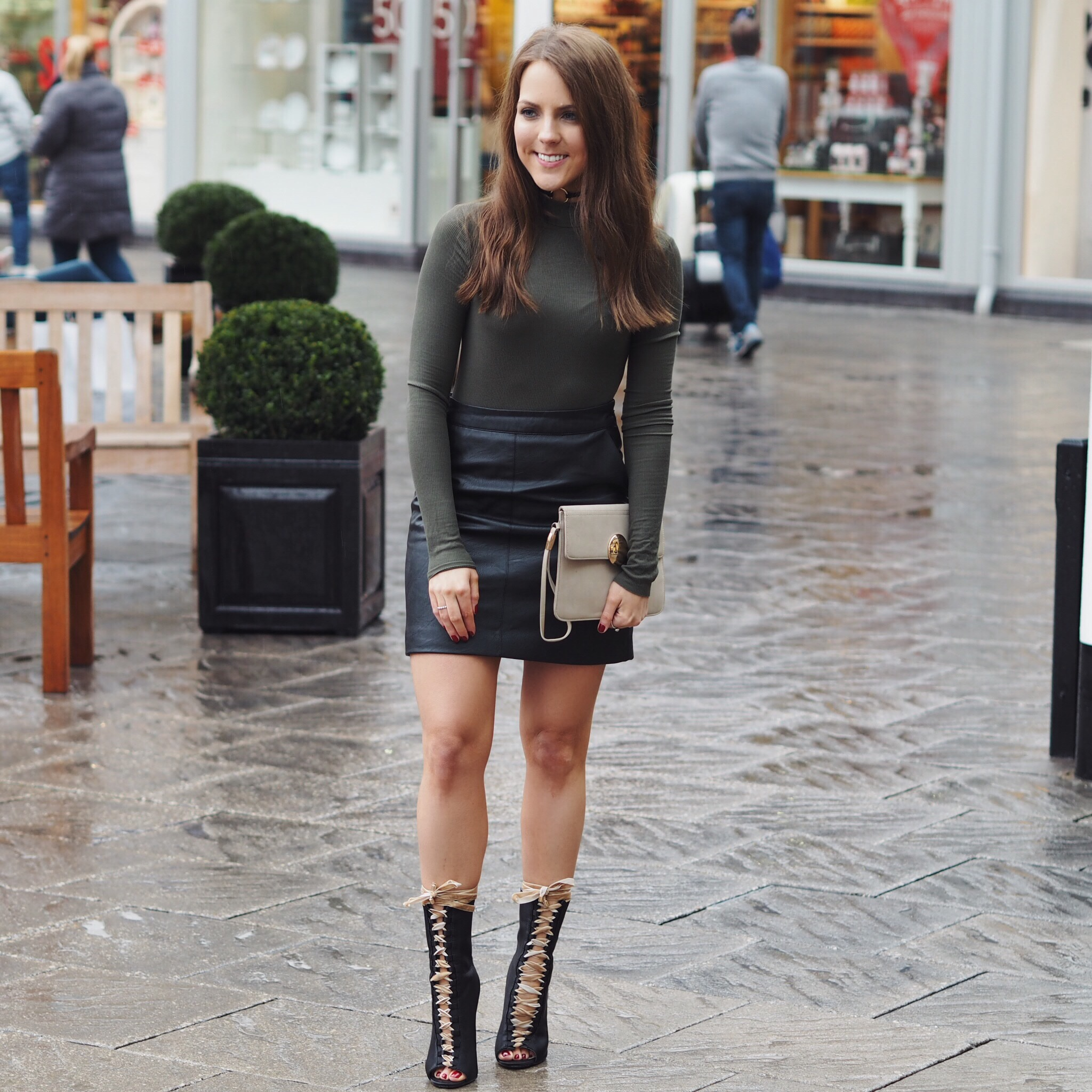 f89f5c74767 Zara khaki top, Topshop black leather skirt and Ego lace-up boots ...