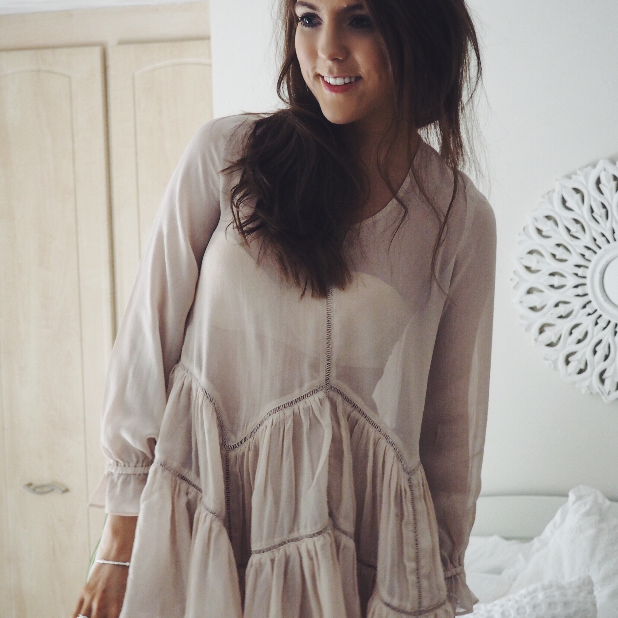 Bohemian vibes. Fashion blogger wearing ruffle hem swing dress
