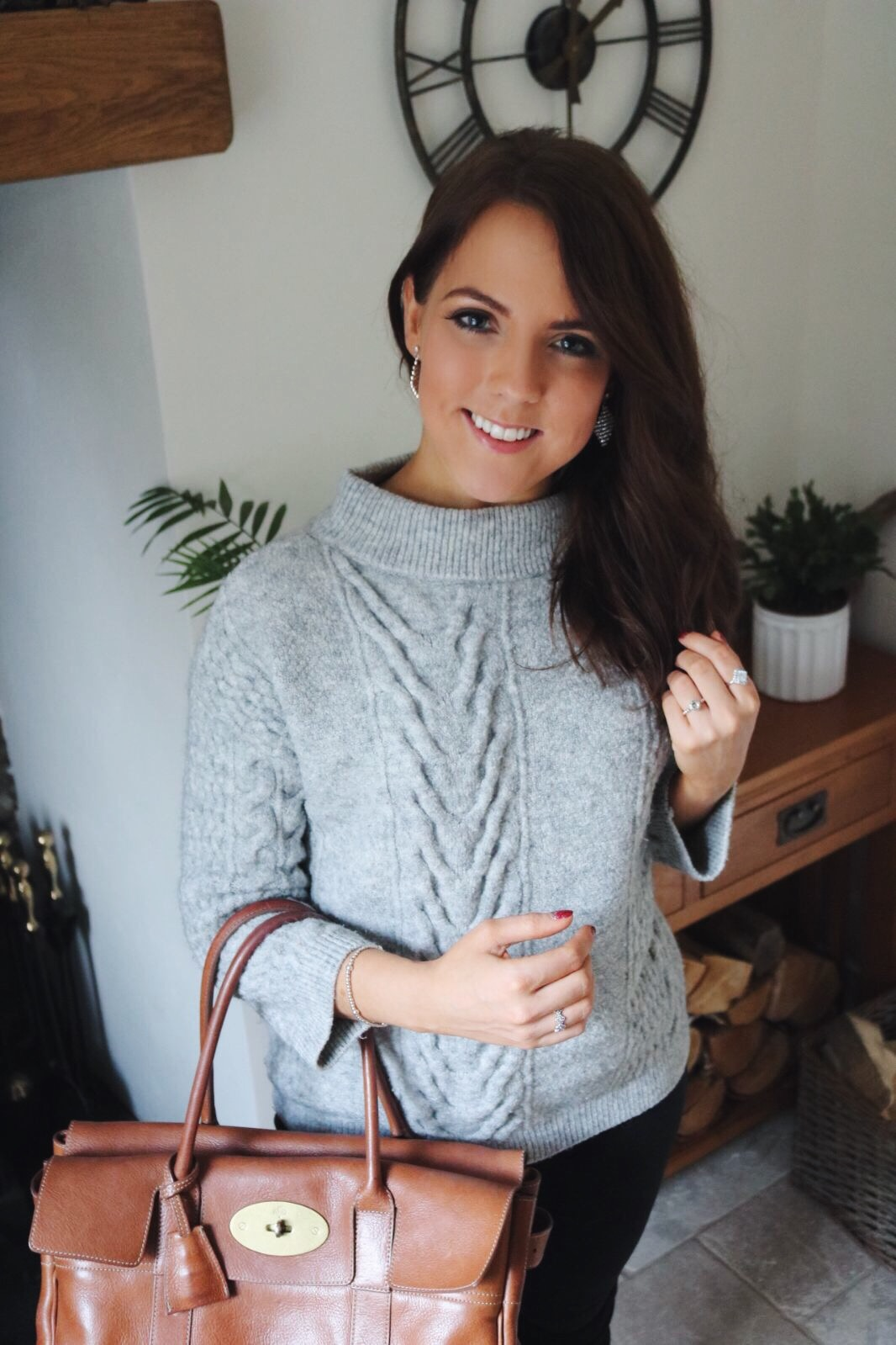 Black jeans, grey jumper and Mulberry bag