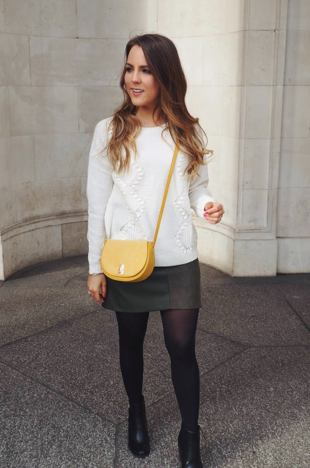 Oasis Martini Mac, Khaki suede skirt, yellow cross body bag, cream cable knit jumper, high heeled black boots
